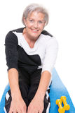 Senior woman at workout. Active senior woman at workout in front of white background Stock Photo