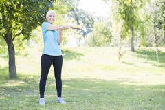 Senior woman workout in the park stock photography