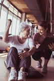 Senior woman workout in rehabilitation center. Senior women workout in rehabilitation center. Personal trainer writing record exercise Royalty Free Stock Photos