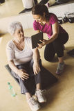 Senior woman workout in rehabilitation center. Stock Images