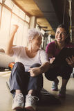 Senior woman workout in rehabilitation center. Royalty Free Stock Images