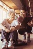 Senior woman workout in rehabilitation center. Royalty Free Stock Photos