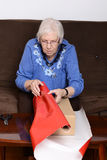 Senior woman wrapping christmas gift Royalty Free Stock Photos