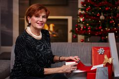 Senior woman wrapping christmas presents Royalty Free Stock Images