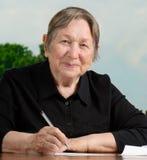 Senior woman  writing Royalty Free Stock Image