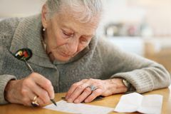 Senior woman writing stock images