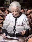 Senior woman writing notes Royalty Free Stock Images