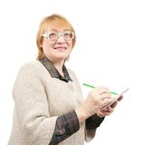 Senior woman writing on a papers Royalty Free Stock Photos