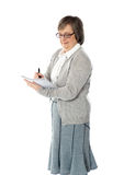 Senior woman writing in spiral notebook Royalty Free Stock Photography