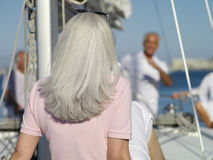 Senior woman on yacht, rear view Royalty Free Stock Photos