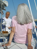 Senior woman on yacht, rear view Royalty Free Stock Photography