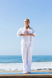 Senior woman yoga beach Royalty Free Stock Photography