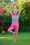 Senior woman yoga royalty free stock photography