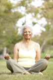 Senior Woman Yoga In Park Royalty Free Stock Photography