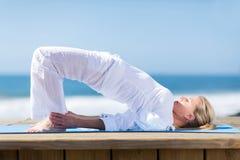 Senior woman yoga royalty free stock image