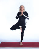 Senior Woman in Yoga Pose Stock Images