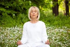Senior woman yoga. Senior woman relaxation practising yoga Royalty Free Stock Images