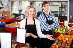 Senior woman and young man offering seasonal fruits Royalty Free Stock Photo