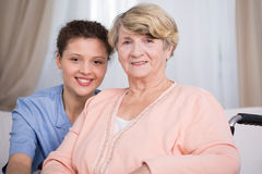 Senior woman and young nurse royalty free stock photo