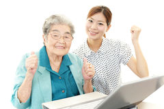 Senior woman and young woman stock image