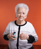 Senior womanholding asthma inhaler Stock Photos
