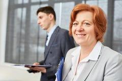 Senior woman as experienced consultat Royalty Free Stock Photo