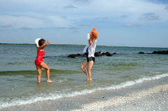 Senior women beach vacation. Two senior women in swim suits at the beach excited for vacation Stock Images