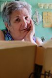 Senior women with book looking at camera Stock Photography