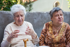 Senior women chatting Stock Image