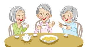 Senior women cheerful tea time white background Stock Photos