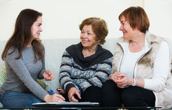 Senior women consulting with banking agent Stock Photos
