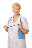 Senior women doctor with stethoscope and pointer royalty free stock photos