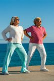 Senior women doing exercise outdoors. Stock Photography