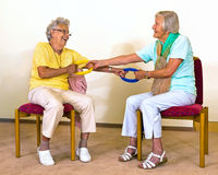 Senior women doing partner stretches. Royalty Free Stock Image