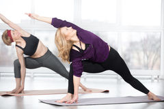 Senior women doing Utthita parsvakonasana Royalty Free Stock Images