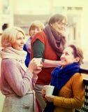 Senior women drinking tea at balcony Stock Photo