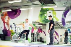 Senior woman exercising. Senior women exercising at gym Stock Photo