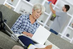 Senior woman in front laptop. Senior women in front of a laptop Stock Photography
