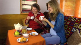 Senior women and girl have weekend afternoon talk on tea table stock footage
