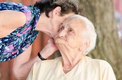 Senior women gossip Stock Photos