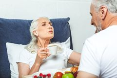 Woman having breakfast in the bed stock photo