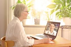 Senior woman doctor online consultation stock images