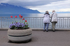 Senior women at lake Geneva waterfront Royalty Free Stock Image