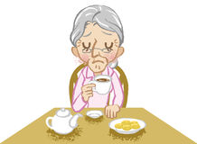 Senior women lonely tea time white background Royalty Free Stock Photos