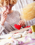 Senior women making ornaments at home Stock Photos
