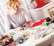 Senior women making ornaments at home Royalty Free Stock Image