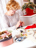 Senior women making ornaments at home Stock Photo