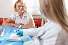 Senior woman during a medical exam with practitioner royalty free stock photos
