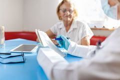 Senior woman during a medical exam with practitioner royalty free stock images