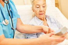 Senior woman is being cared for by caregiver royalty free stock images